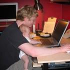 Baby girl helping Daddy work.